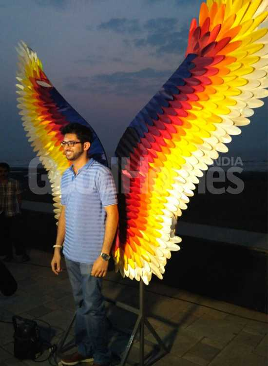 Aaditya Thackeray posing in front of 'Phoenix Rises'