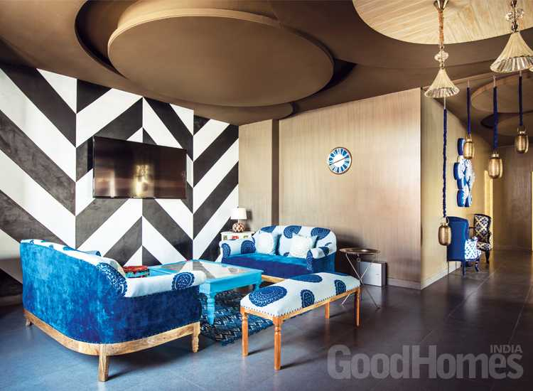 Living Room by Shantanu Garg - black and white stripes wall and blue-white sitting,brown walls