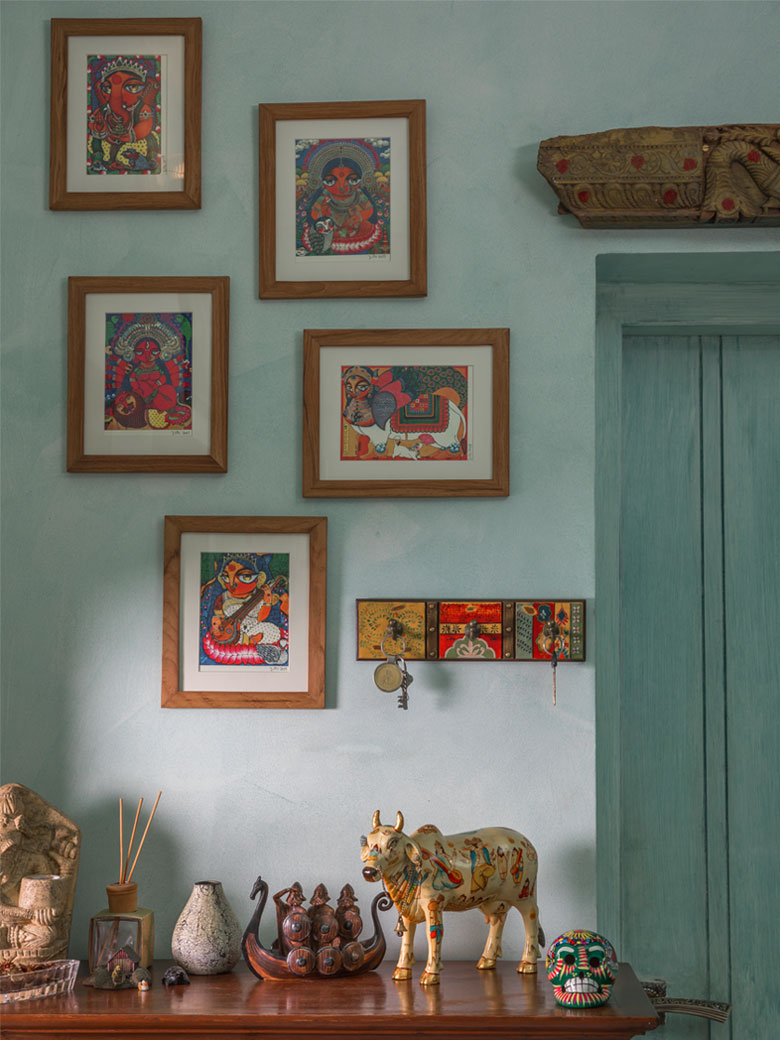 Abstract art on a blue wall with wooden frames