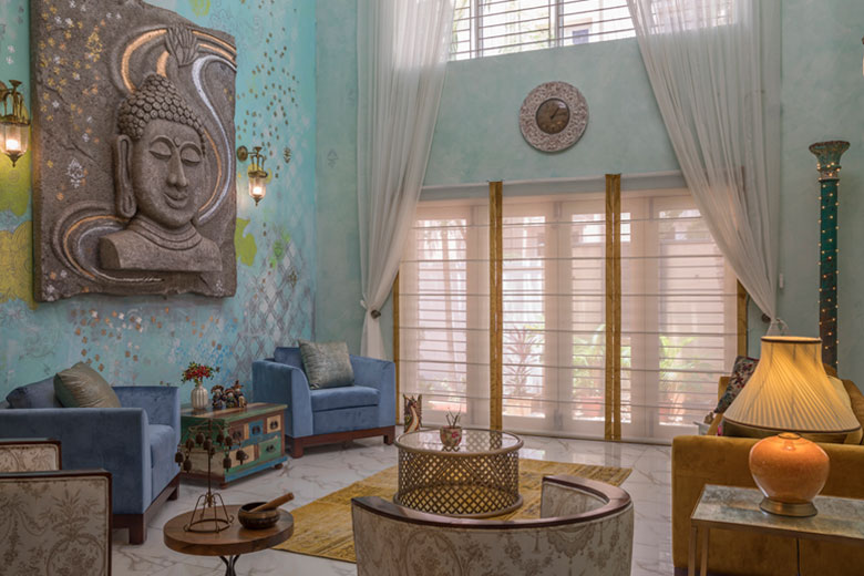 Blue room with a buddha art piece