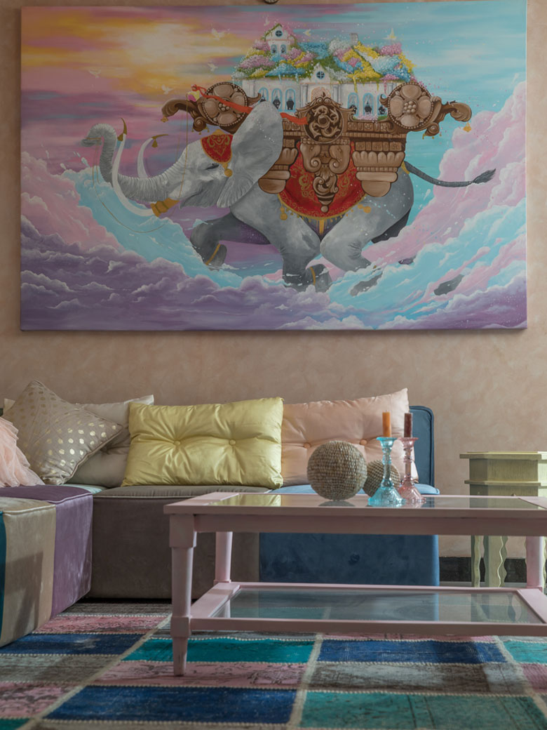 Peach room with a grand pastel painting