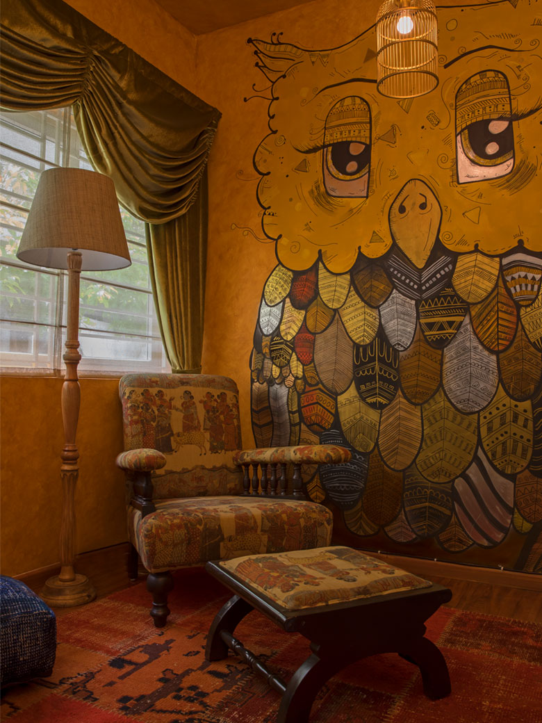 Yellow room with owl wallpaper