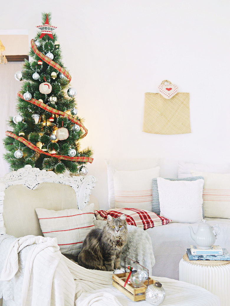 Decorated Christmas tree with a cat at the base