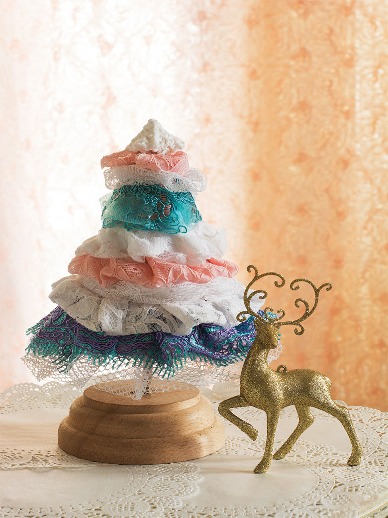 Fabric Christmas tree decoration with a golden reindeer