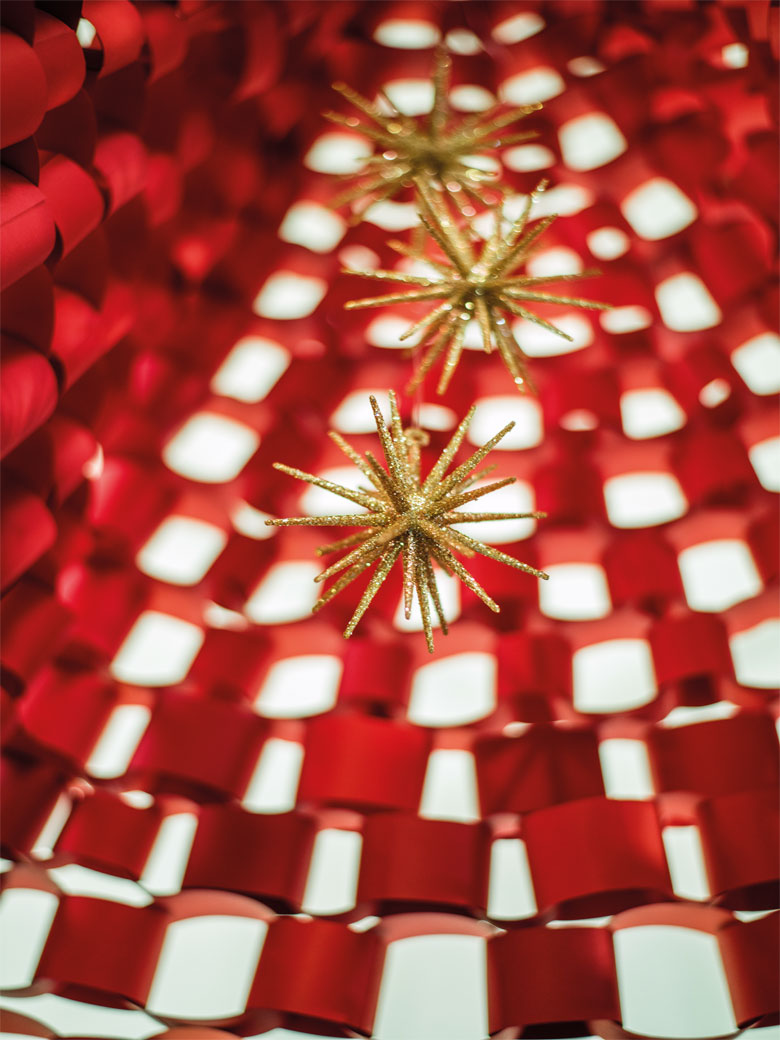Golden ornaments on a red background