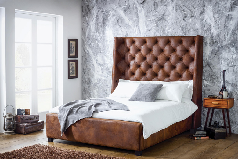 bedroom with leather headboard and marble walls