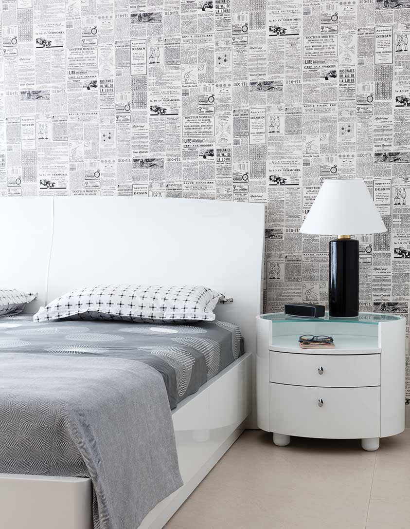 Bedroom with newspaper wallpaper and gray shades