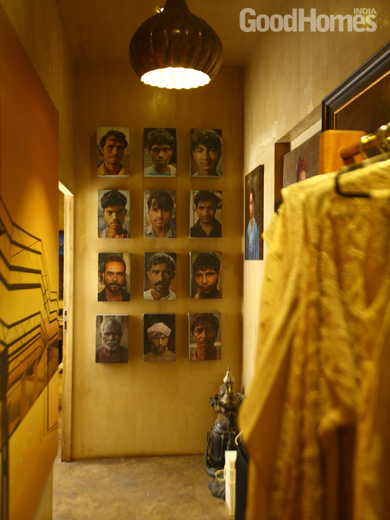 A wall with a cluster of portraits