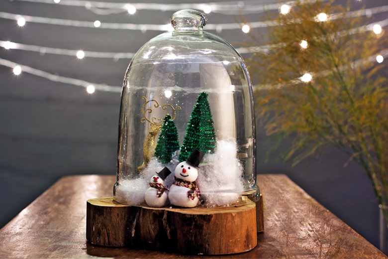 Snow globe with tiny snowmen and Christmas trees