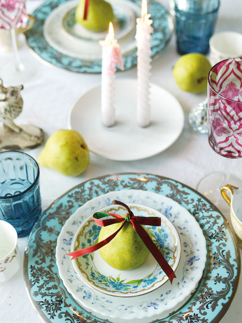 Table spread with beautiful blue and white ceramic plates and pears