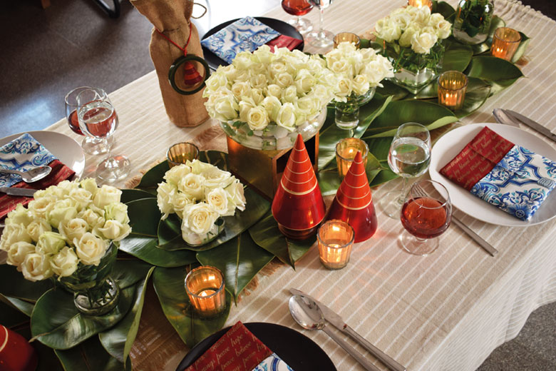 Table spread decorated with roses and stripe sheets