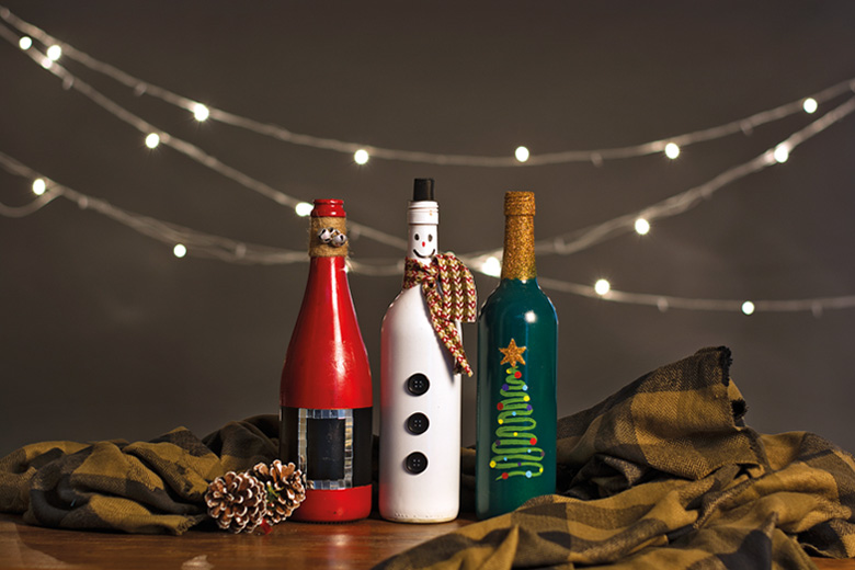 Three bottles with cute Christmas decorations