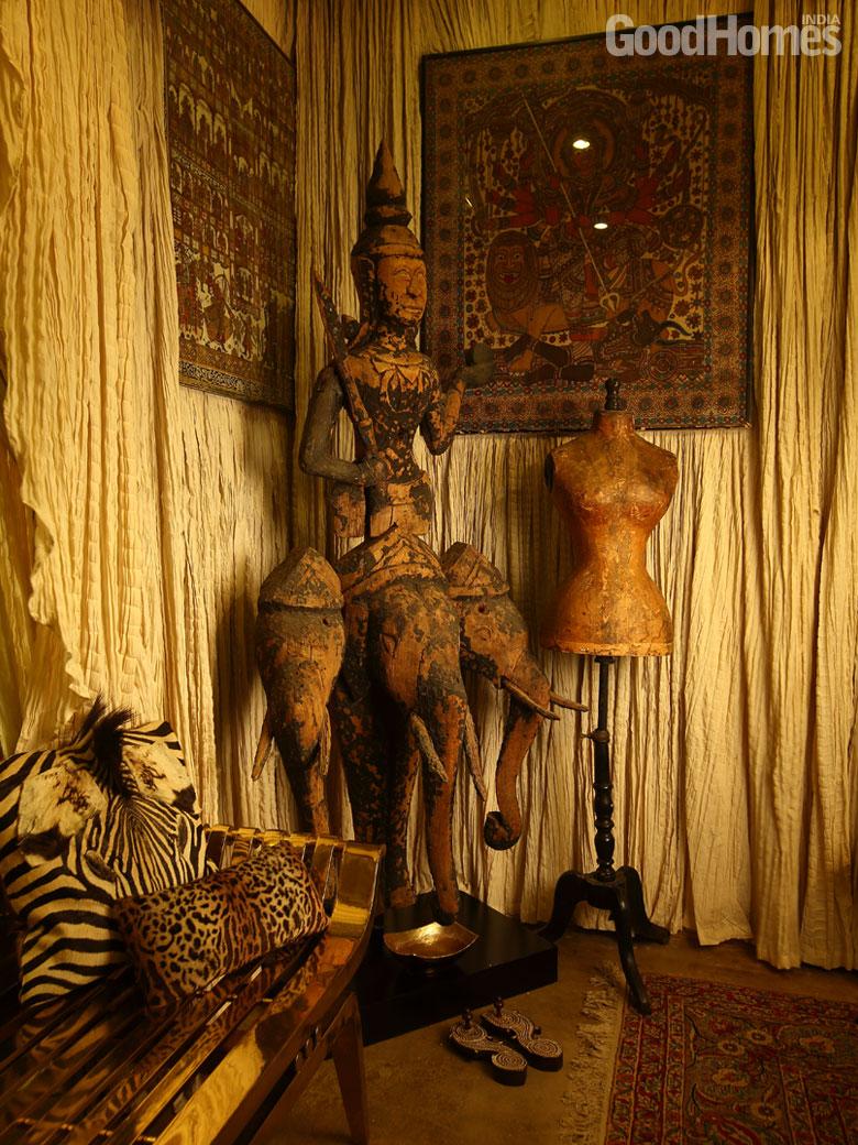 art with three elephant head and a human body
