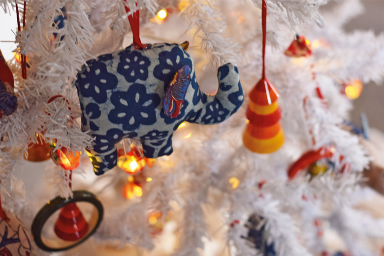 White Christmas tree with elephant ornaments