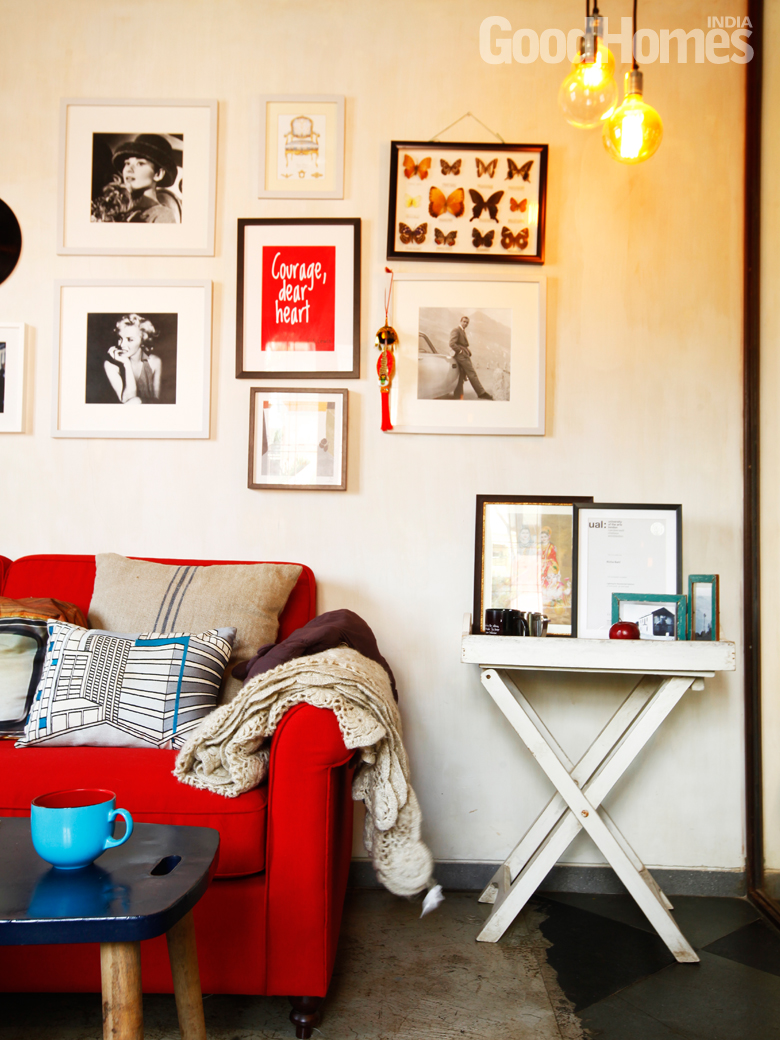 Red sofa and prints as art work