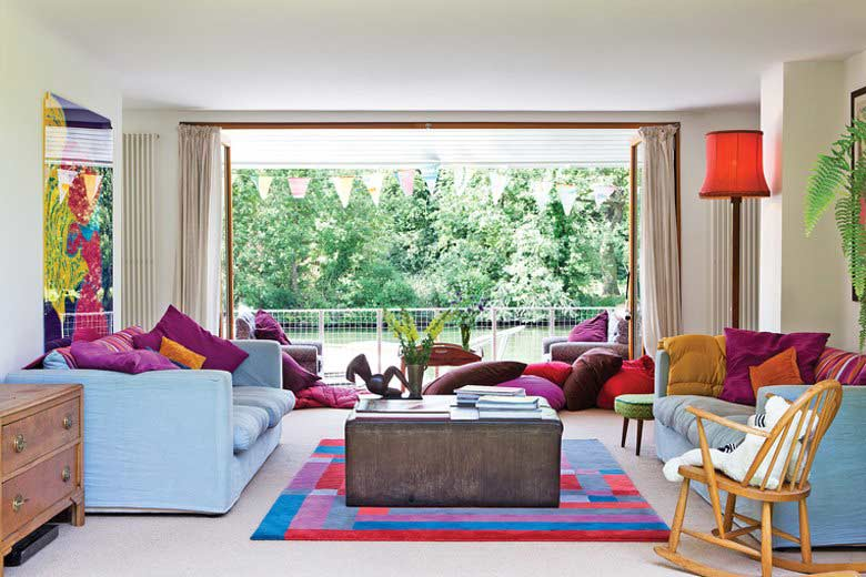 Light and airy living room with colourful but decent decor