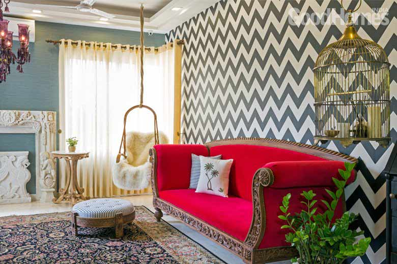 Chevron wall with red coloured furniture set living room