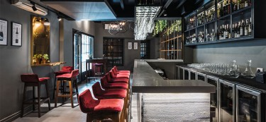 A play of textures creates a European experience in this lounge bar