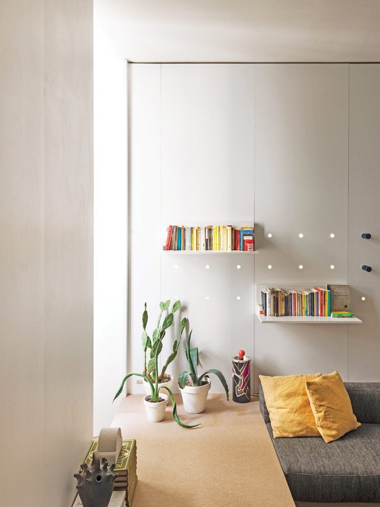 White wall with books