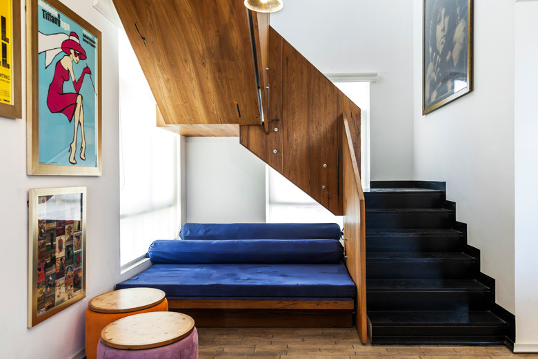 Staircase with blue sofa