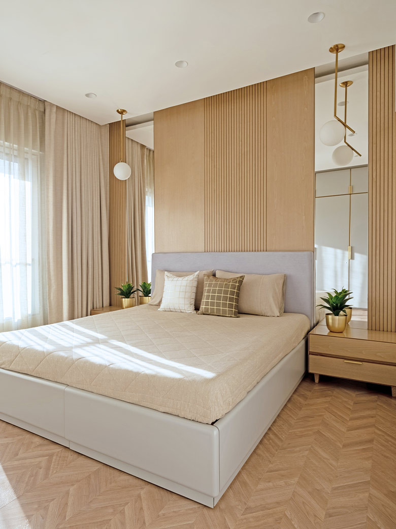 The aesthetic quality of the bedroom is reinforced by fishbone patterned parquet flooring; Photography by Kuber Shah