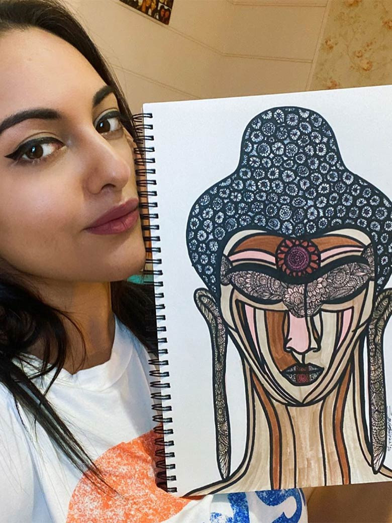 Sonakshi Sinha with her art piece for auction